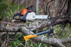 An axe and chainsaw Stock Photos