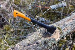 An axe and chainsaw Royalty Free Stock Photography