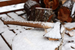 Axe on chopping block in winter Stock Images