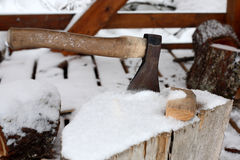 Axe on chopping block in winter Stock Image