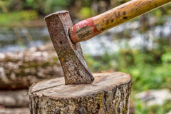 Axe on chopping block Stock Photo