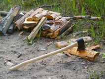 Axe chopping firewood. Axe blade resting in a piece of firewood Stock Photo