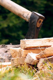 Axe and chunks. With blurry background Royalty Free Stock Photo