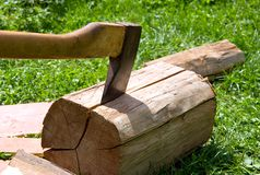 Axe cuts the wood. Royalty Free Stock Image