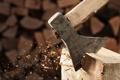 Axe cutting wood block Royalty Free Stock Image
