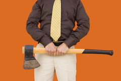 Axe for down sizing. A businessman with a axe for cutting expenses Stock Images