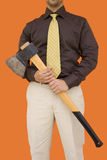 Axe for downsizing 2. A businessman with a axe for cutting expenses Royalty Free Stock Photos