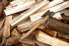 Axe on a dump of chipped firewood Stock Images