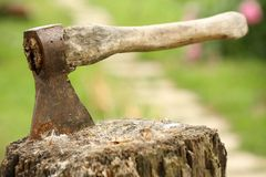 Axe on an executioner's block Stock Photos