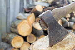 Axe and fire wood Stock Photo