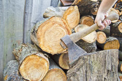 Axe and fire wood Stock Images