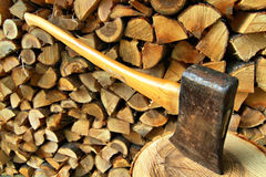 Axe and firewood Stock Photos