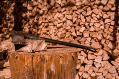 Axe and firewood. In Finland almost all saunas heated up with firewood. This photo is shot in summer cottage 2014 july - for heating sauna Stock Photo