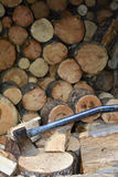 Axe and firewood Royalty Free Stock Images