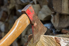 Axe in front of a stack of wood Stock Images