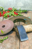 Axe and grindstone. On the wooden table Stock Images