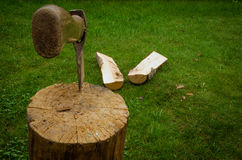The axe has split a log Royalty Free Stock Photography