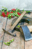 Axe and hummer. Axe, hummer and grindstone on the wooden table Royalty Free Stock Images