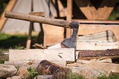 Axe impaled in log and fragments Stock Photos