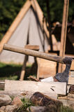 Axe impaled in log and fragments Stock Photo