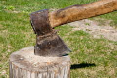 Axe In Log. An axe in a wood trunk royalty free stock photos
