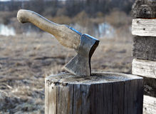 Axe in a log. Closeup Stock Images