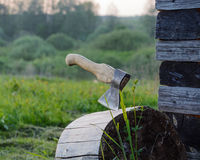 Axe in a log Stock Images