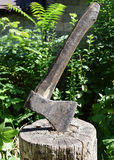 Axe in a log, closeup. Axe the most essential tool in the economic activity of the person is used since ancient times Stock Photography