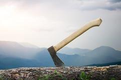 Axe in a log, closeup Royalty Free Stock Photo