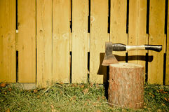 Axe in log. Mysterious scenery mood Stock Images