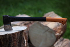 Axe in a log outdoors. Chopping wood - axe in a log outdoors Royalty Free Stock Photos
