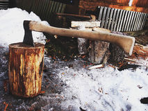 Axe in a log, rustic background Royalty Free Stock Photos