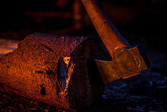 Axe in log whilst camping Royalty Free Stock Images