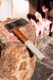 Axe lying on a stump Royalty Free Stock Photos