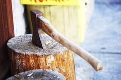 Axe. Metal axe blade in wood stock photos