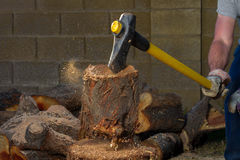 Axe in Motion Pulling Up a Log After Hitting It stock photos