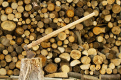 Axe near firewood stack Stock Photos