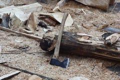 Axe near a log. Stock Photos