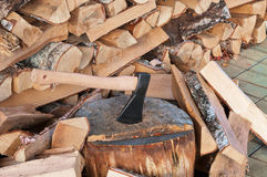 Axe over pile of wood background. Stock Images