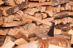 Axe over pile of wood background. Royalty Free Stock Image