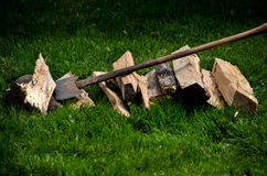 Axe and pile of wood Royalty Free Stock Image