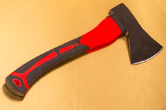 Axe with the red ax handle Stock Photography