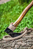 Axe and rope on wood Stock Images