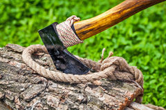 Axe and rope on wood Stock Photos