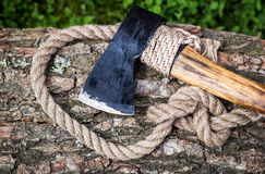 Axe and rope on wood Royalty Free Stock Photos
