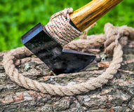 Axe and rope on wood Royalty Free Stock Photo
