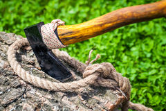 Axe and rope on wood Stock Image