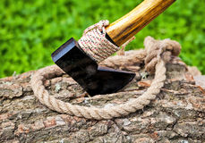 Axe and rope on wood Royalty Free Stock Image