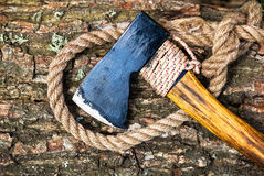 Axe and rope on wood Stock Photography