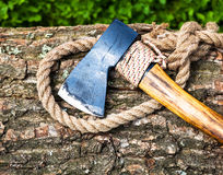 Axe and rope on wood Royalty Free Stock Images